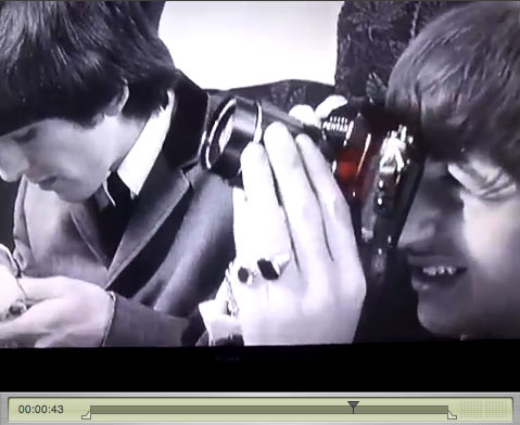 Still from A Hard Days Night: Ringo with a camera.