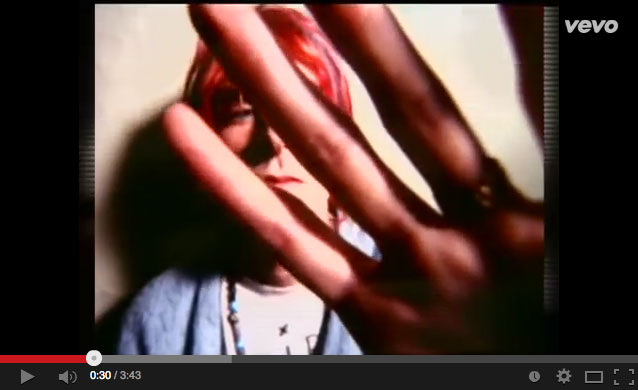 still from video showing Cobain's hand