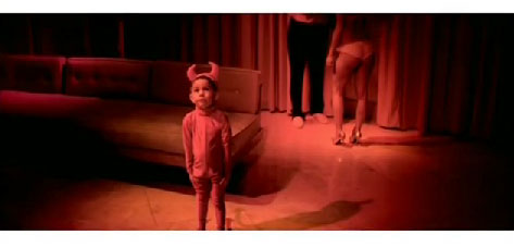 still from Kanye West's Gold Digger - little boy dressed in a devil outfit