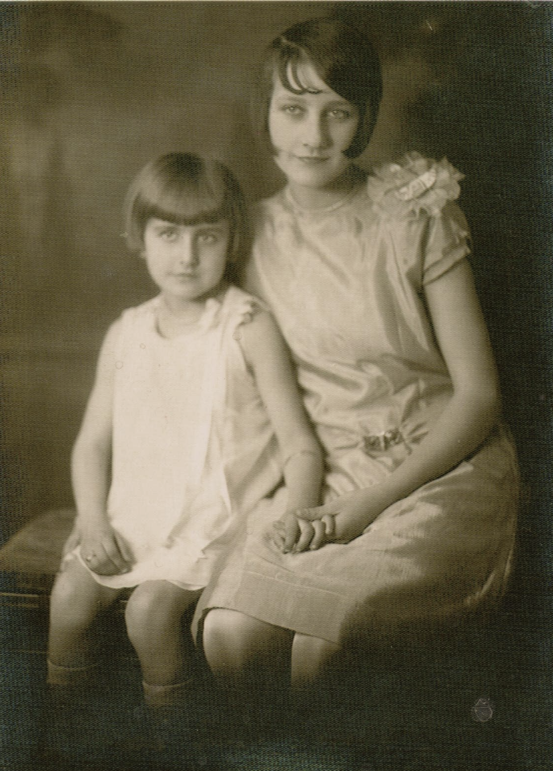 Shirley Grace Cooper (age about 9 years) and older sister Mildred (age about 17 years)